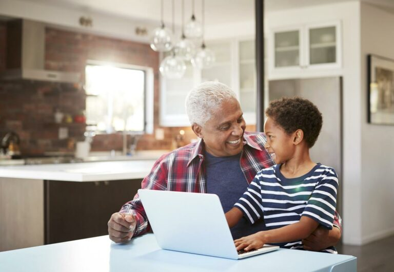 SoCo Village | Senior and his grandson on a laptop