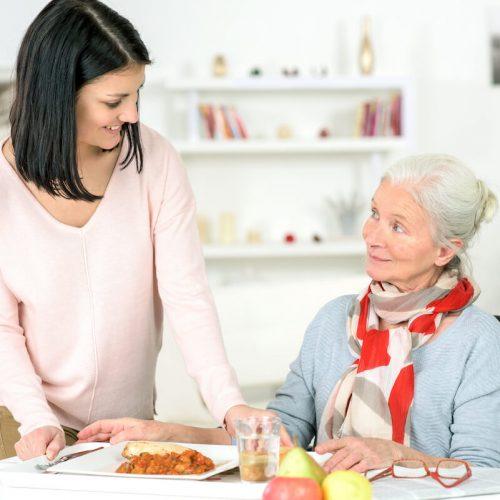 SoCo Village | Senior having a meal