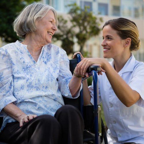 SoCo Village | Caregiver with senior in wheelchair